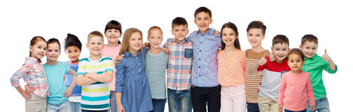Group of happy smiling children hugging Stock Photos