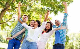 Group of happy smiling friends having fun outdoors royalty free stock images