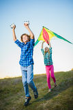 Group of happy and smiling kids playingin with kite outdoor Royalty Free Stock Image