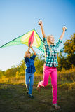 Group of happy and smiling kids playingin with kite outdoor stock photo