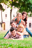Group of happy smiling Teenage Students Outside Stock Image