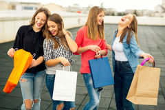 Group of happy smiling women shopping with colored bags Stock Photo