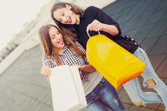 Group of happy smiling women shopping with colored bags Royalty Free Stock Photo