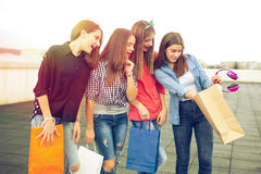 Group of happy smiling women shopping with colored bags Stock Photos