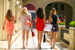 Group of happy smiling women shopping Stock Photos