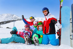 Group of happy snowboarders in the mountains Stock Image
