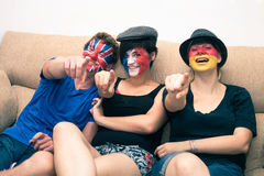 Group of happy sports fans pointing. Group of ecstatic sports fans cheering at home and pointing at you stock photography