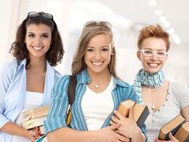 Group of happy student girls on school corridor Royalty Free Stock Photography