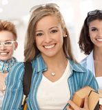 Group of happy student girls on school corridor. Looking at camera, smiling Royalty Free Stock Photography