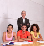 Group of happy students. Studying with lecturer Royalty Free Stock Photo