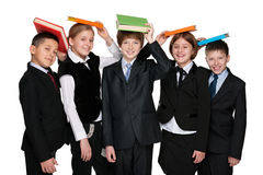 Group of happy students with books. A group of five happy students with books on the white background Stock Photography