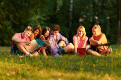 Group of happy students with books in the Park Stock Image