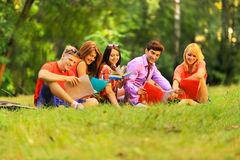 Group of happy students with books in the Park Stock Photos