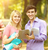 Group of happy students with books the Park on a Sunny day. Royalty Free Stock Image