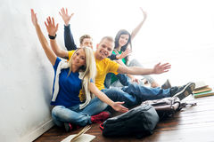Group of happy students on a break waving. Focus on students. Background is blurry Stock Photography
