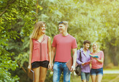 Group of happy students come and discuss training in the park Royalty Free Stock Image