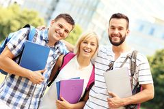 Group of happy students in front of modern buildingd Royalty Free Stock Photo