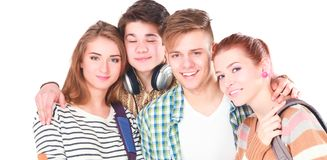 Group of happy students. Isolated over white background.  Stock Image