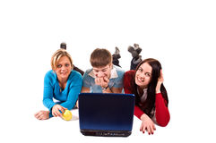 Group of happy students with the laptop. (isolated on white royalty free stock photos