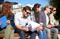 Group of happy students with notebooks and coffee Stock Image