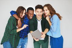 Group of happy students people friends with phones tablets gadgets laugh royalty free stock images