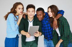 Group of happy students people friends with phones tablets gadgets laugh. A group of happy students people friends with phones tablets gadgets laugh royalty free stock images