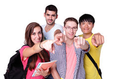 Group of happy students pointing. Friend group of happy students pointing to you isolated over a white background,  caucasian and asian Royalty Free Stock Images