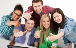 Group of happy students showing thumbs up Royalty Free Stock Image