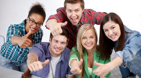 Group of happy students showing thumbs up Royalty Free Stock Photography