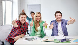 Group of happy students showing thumbs up Royalty Free Stock Photo