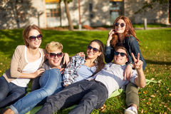 Group of happy students showing victory gesture Stock Photography