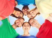 Group of happy students standing together and looking at camera over blue background. School, university, education, concept. stock photos