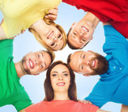 Group of happy students standing together and looking at camera over blue background. School, university, education, concept. royalty free stock photo