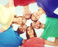 Group of happy students standing together and looking at camera over blue background. School, university, education, concept. royalty free stock photos