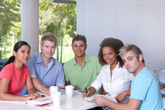 Group of happy students studying. By the table Royalty Free Stock Photography