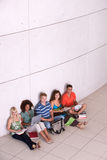 Group of happy students studying. In the corridors Royalty Free Stock Photography
