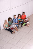 Group of happy students studying. And sitting on the floor Royalty Free Stock Image