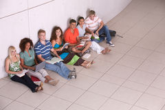 Group of happy students studying Royalty Free Stock Photography