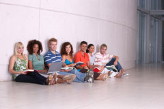 Group of happy students studying. And sitting on the floor Stock Photo