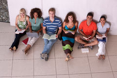 Group of happy students studying. In the corridors Stock Image
