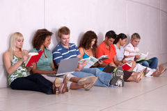 Group of happy students studying. In the corridors Royalty Free Stock Photo