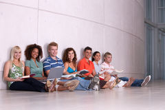 Group of happy students studying. In corridor Stock Images