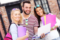 Group of happy students studying outdoors Royalty Free Stock Photos