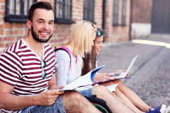 Group of happy students studying outdoors Royalty Free Stock Photo