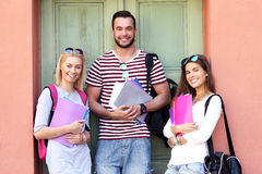 Group of happy students studying outdoors Stock Photo