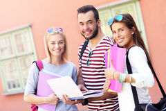 Group of happy students studying outdoors Stock Images