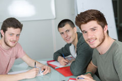 Group happy students studying together in classroom Stock Image