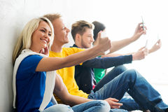 Group of happy students taking selfies Royalty Free Stock Photo