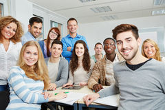 Students with teacher and tablet. Group of happy students with teacher and tablet computer in class stock image