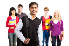 Group of happy students. On a white backgroud Stock Photos